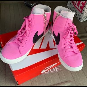 Pink high top Nike shoes